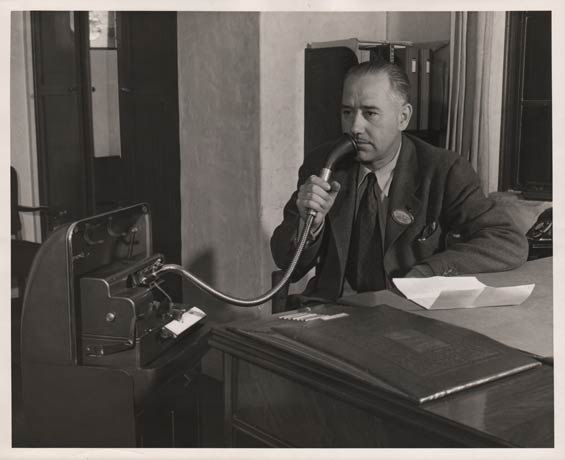 E.C. McLeod Dictating, Ca. 1942