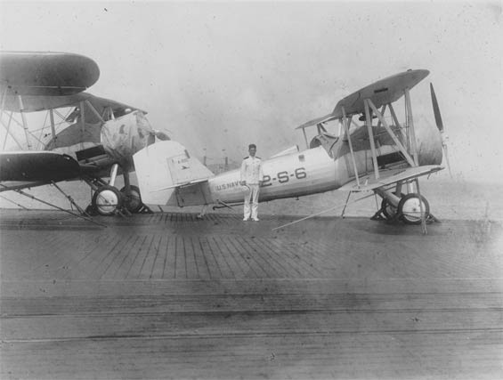 Unidentified Officer and Vought Corsair, A-8110, Carrier Deck, Ca. 1928-30 (Source: Barnes)