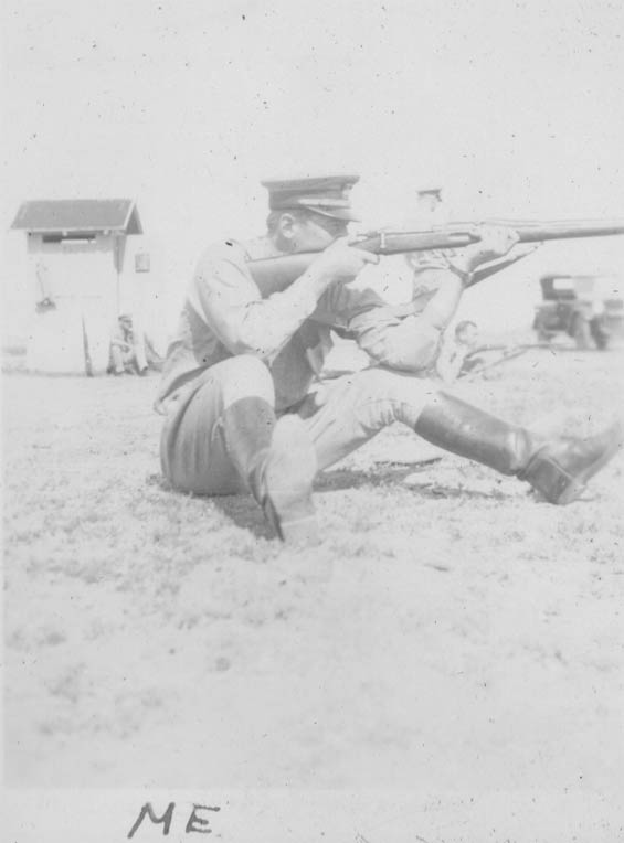 McMullen Firing a Rifle From a Seated Position, Ca. 1928-30 (Source: Barnes)