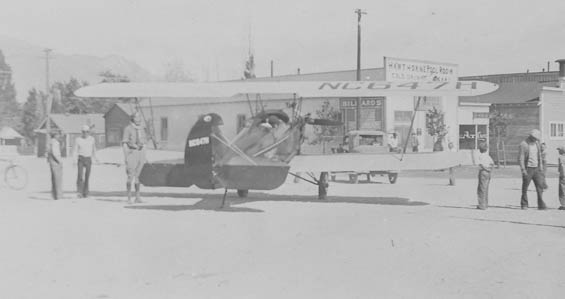 Travel Air NC647H in Front of the Hawthorne Pool Hall, Date Unknown (Source: Guyer)